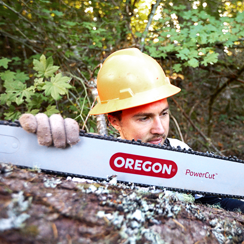 Man holding Oregon PowerCut Guide Bar